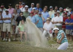 Rickie Fowler hits out of the bunker on the 11th hole during the third round of the U.S. Open golf tournament in Pinehurst, N.C., Saturday, June 14, 2014. (AP Photo/Charlie Riedel)