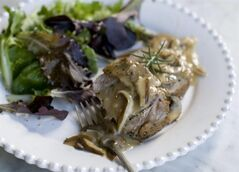 This Nov. 18, 2013 photo shows double pork roast with mushroom marsala sauce in Concord, N.H. (AP Photo/Matthew Mead)