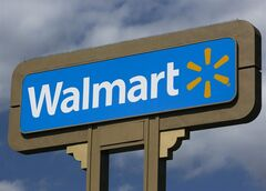FILE - In this Tuesday, May 28, 2013, file photo, An outdoors sign for Walmart is seen in Duarte, Calif. As more stores push for Thanksgiving shoppers, Wal-Mart Stores Inc. said Tuesday, Nov. 12, 2013, that it will start to offer its holiday blockbuster deals at 6 p.m. on Thanksgiving at its stores, two hours earlier than last year. (AP Photo/Damian Dovarganes, File)