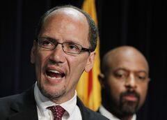 FILE - In this Thursday, May 10, 2012 file photo, United States Assistant Attorney General Thomas Perez, left, is joined by Deputy Assistant Attorney General for Civil Rights, Roy Austin, as Perez announces a federal civil lawsuit against Maricopa County Sheriff Joe Arpaio during a news conference in Phoenix. The White House says President Barack Obama on Monday, March 18, 2012 will nominate Perez to head the Labor Department. (AP Photo/Ross D. Franklin, File)