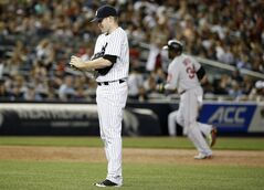 Boston Red Sox designated hitter David Ortiz trots the bases, right, as New York Yankees starting pitcher Chase Whitley reacts after allowing Ortiz a third-inning, three-run home run in a baseball game at Yankee Stadium in New York, Sunday, June 29, 2014. (AP Photo/Kathy Willens)