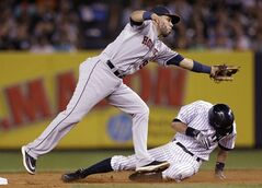 Houston Astros' Marwin Gonzalez (9) fields the ball as New York Yankees' Ichiro Suzuki, of Japan, steals second base during the fifth inning of a baseball game Wednesday, Aug. 20, 2014, in New York. (AP Photo/Frank Franklin II)