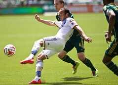 PORTLAND, OREGON - May 11, 2014 - Los Angeles Galaxy midfielder Landon Donovan, front, clears a ball against Portland Timbers midfielder Will Johnson (4) Sunday May 11, 2014, at Providence Park in Portland, Oregon. (AP Photo/The Oregonian, Thomas Boyd) MAGS OUT; TV OUT; LOCAL TV OUT; LOCAL INTERNET OUT; THE MERCURY OUT; WILLAMETTE WEEK OUT; PAMPLIN MEDIA GROUP OUT