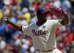 Philadelphia Phillies starting pitcher Jerome Williams throws against the St. Louis Cardinals in the first inning of a baseball game Sunday, Aug. 24, 2014, in Philadelphia. (AP Photo/H. Rumph Jr)