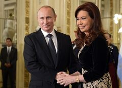 Russian President Vladimir Putin, left, shakes hands with Argentina's President Cristina Fernandez at Government Palace during a one-day visit, in Buenos Aires, Argentina, Saturday, July 12, 2014. Putin's next stop is Brazil for a presidential summit of the BRICS group of nations in Fortaleza. He was also to attend the final World Cup match in a ceremonial handover of host duties for soccer's marquee tournament, which takes place in Russia in 2018. (AP Photo/RIA-Novosti, Alexei Nikolsky, Presidential Press Service)