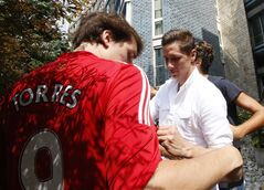 Spanish striker Fernando Torres, right, signs autographs to AC Milan supporters as he arrives at the