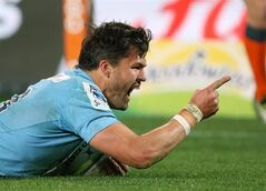 Waratahs' Adam Ashley-Cooper celebrates after diving over to score a try against the Crusaders during their Super Rugby final match in Sydney, Saturday, Aug. 2, 2014. (AP Photo/Rick Rycroft)