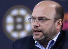 Boston Bruins general manager Peter Chiarelli responds to a question from a reporter during a news conference at the TD Garden before a scheduled NHL team hockey practice in Boston, Sunday, Jan. 13, 2013. The Bruins have signed general manager Chiarelli to a four-year contract extension through the 2017-18 season. THE CANADIAN PRESS/AP/Steven Senne