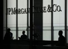 The JPMorgan Chase & Co. logo is displayed at their headquarters in New York, Oct. 21, 2013. THE CANADIAN PRESS/AP, Seth Wenig