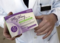 This May 2, 2013 photo shows pharmacist Simon Gorelikov holding a generic emergency contraceptive at the Health First Pharmacy in Boston.THE CANADIAN PRESS/AP, Elise Amendola