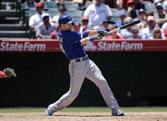 Toronto Blue Jays' Nolan Reimold hits a two-run double during the fourth inning of a baseball game against the Los Angeles Angels on Wednesday, July 9, 2014, in Anaheim, Calif. THE CANADIAN PRESS/AP/Jae C. Hong
