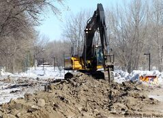 Brandon city crews begin work on diking near the Assiniboine River to prevent spring flooding.