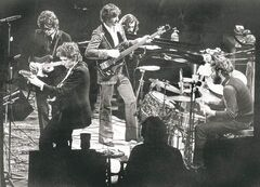 Bob Dylan (foreground left) joins The Band (from left) Robbie Robertson, Rick Danko, Richard Manuel and Levon Helm at a 1974 concert at the Forum in Inglewood, Calif.