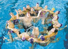 Doug Speirs -- he's the one in the middle -- practises with members of the Aquatica Synchro Club.