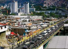 The hearse with the coffin containing the remains of Hugo Chavez is driven to his resting place.