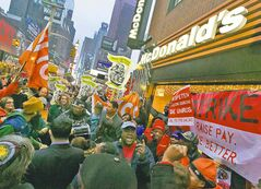 Protesters in New York call for a wage increase for fast-food workers Thursday as part of nationwide demonstrations.