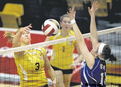Crocus's Lindsay McLaughlan (left) flicks it by Lord Selkirk's Brittany Kiesman.