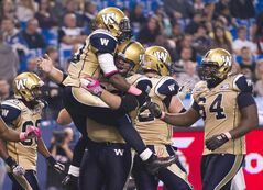 Winnipeg Blue Bombers running back Will Ford, left to right, celebrates his touch down with teammates Justin Sorensen and Chris Greaves during second half CFL football action in Toronto on Friday.