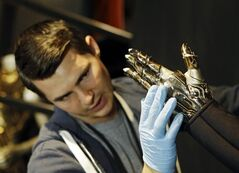 In this Thursday, july 17, 2014 photo, Matt Seaman adjust the glove from Beyonc�'s
