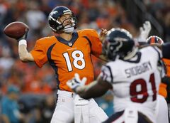 Denver Broncos quarterback Peyton Manning (18) throws under pressure from Houston Texans defensive end Lawrence Sidbury (91) during the first half of an NFL preseason football game, Saturday, Aug. 23, 2014, in Denver. (AP Photo/Joe Mahoney)