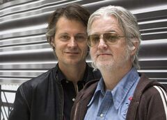 Jim Cuddy (left) and Greg Keelor of Blue Rodeo pose for a photo in Toronto on Monday November 9, 2009. The singer-songwriters behind the enduring success of the band Blue Rodeo headline a talented cast of new appointments to the Order of Canada.THE CANADIAN PRESS/Frank Gunn