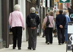 Senior citizens make their way down the a main street in Peterborough, Ontario on Monday May 7, 2012. THE CANADIAN PRESS/Frank Gunn