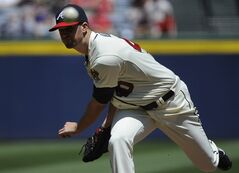 Atlanta Braves starting pitcher Alex Wood delivers to the San Francisco Giants during the first inning of a baseball game on Sunday, May 4, 2014, in Atlanta. (AP Photo/David Tulis)