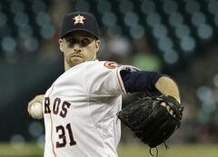 Houston Astros' Collin McHugh delivers a pitch against the Minnesota Twins in the first inning of a baseball game Tuesday, Aug. 12, 2014, in Houston. (AP Photo/Pat Sullivan)