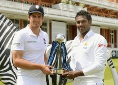 England's Alastair Cook, left, and Sri Lanka's Angelo Matthews pose with the series trophy during a nets session at Lords Cricket Ground, London Wednesday June 11, 2014. The first test in the current series between the two sides begins at Lord's on Thursday. (AP Photo/Anthony Devlin/PA) UNITED KINGDOM OUT NO SALES NO ARCHIVE