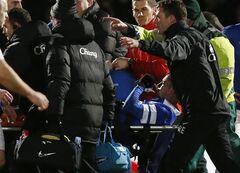 Everton's Bryan Oviedo is carried off the pitch after an injury during their English FA Cup fourth round soccer match against Stevenage at the Lamex Stadium, Stevenage, England, Saturday, Jan. 25, 2014. (AP Photo/Sang Tan)