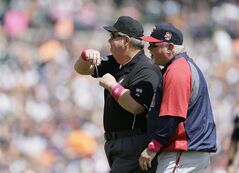 Minnesota Twins manager Ron Gardenhire is thrown out by umpire Joe West during the fourth inning of a baseball game against the Detroit Tigers in Detroit, Sunday, May 11, 2014. (AP Photo/Carlos Osorio)