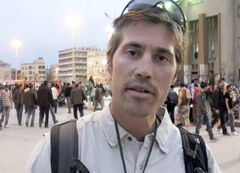 FILE - This undated file still image from video released April 7, 2011, by GlobalPost, shows James Foley of Rochester, N.H., a freelance contributor for GlobalPost, in Benghazi, Libya. In a horrifying act of revenge for U.S. airstrikes in northern Iraq, militants with the Islamic State extremist group have beheaded Foley — and are threatening to kill another hostage, U.S. officials say. (AP Photo/GlobalPost, File)