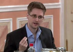 FILE - In this file image made from video released by WikiLeaks on Friday, Oct. 11, 2013, former National Security Agency systems analyst Edward Snowden speaks during a presentation ceremony for the Sam Adams Award in Moscow, Russia. In an interview with the New York Times posted to its website on Thursday, Oct. 17, 2013, Snowden says that he did not take any secret NSA documents to Russia and that intelligence officials in China as well as Russia could not get access to the documents he had obtained before leaving the United States. (AP File Photo)