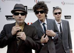 FILE - This June 5, 2007 file photo shows The Beastie Boys, from left, Adam Horovitz (Ad-Rock), Michael Diamond (Mike D) and Bassist Adam Yauch (MCA) at the 11th Annual Webby Awards in New York. The iconic hip-hop group has a deal with Spiegel & Grau, an imprint of Random House Inc., for an illustrated oral history. The book, currently untitled, is scheduled for Fall 2015. According to Spiegel & Grau, the book will track the band's rise from its high school years in New York City to its induction in the Rock and Roll Hall of Fame in 2012. (AP Photo/Stephen Chernin, file)