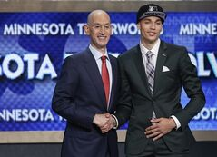 UCLA's Zach LaVine, right, poses for a photo with NBA commissioner Adam Silver after being selected 13th overall by the Minnesota Timberwolves during the 2014 NBA draft, Thursday, June 26, 2014, in New York. (AP Photo/Kathy Willens)