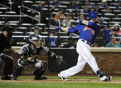 New York Mets' Lucas Duda, right, hits an RBI double off of San Diego Padres starting pitcher Andrew Cashner to tie the score 2-2 in the fourth inning as Rene Rivera catches for the Padres in a baseball game at Citi Field on Friday, June 13, 2014, in New York. (AP Photo/Kathy Kmonicek)