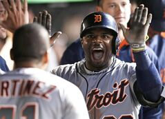 Detroit Tigers' Rajai Davis is congratulated by teammates after hitting a solo home run off Cleveland Indians starting pitcher Trevor Bauer in the seventh inning of a baseball game, Saturday, June 21, 2014, in Cleveland. (AP Photo/Tony Dejak)