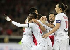 PSG's players celebrate the third goal scored, during their French League one soccer match against Lille at the Lille Metropole stadium, in Villeneuve d'Ascq, northern France, Saturday, May 10, 2014. Paris Saint-Germain have won their second straight French league title. (AP Photo/Michel Spingler)