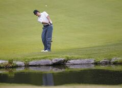 Beau Hossler, who was leading at the start of the final round of the Southern Amateur golf tournament, chips his ball over a water hazard after dropping it Saturday, July 19, 2014, at The Honors Course in Ooltewah, Tenn. M.J. Maguire won the tournament.(AP Photo/Chattanooga Times Free Press, Doug Strickland)