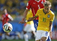 Brazil's Neymar fights for the ball with Chile's Francisco Silva during the World Cup round of 16 soccer match between Brazil and Chile at the Mineirao Stadium in Belo Horizonte, Brazil, Saturday, June 28, 2014. (AP Photo/Frank Augstein)