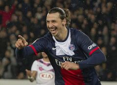Paris Saint Germain's Zlatan Ibrahimovic, right, of Sweden celebrates after scoring against Bordeaux during their French League One soccer match, Friday Jan. 31, 2014, at Parc des Princes stadium, in Paris, France. (AP Photo/Jacques Brinon)