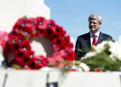 Canadian Prime Minister Stephen Harper stands infront of the cenotaph in the Canadian military cemetery Friday June 6, 2014 in Beny-sur-Mer, France. THE CANADIAN PRESS/Adrian Wyld