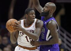 Cleveland Cavaliers' Anthony Bennett, left, tries to get past Sacramento Kings' Quincy Acy during the third quarter of an NBA basketball game Tuesday, Feb. 11, 2014, in Cleveland. Bennett, the 20-year-old rookie from Toronto, the first Canadian ever selected with the first overall pick in the NBA Draft when the Cleveland Cavaliers grabbed him in 2013, has had anything but a storybook beginning to his professional career. THE CANADIAN PRESS/AP/Mark Duncan