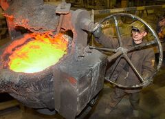A metal industry worker operates a ladle at a metallurgy plant in Kushva, Russia, March 6, 2002. THE CANADIAN PRESS/AP, Alexei Vladykin