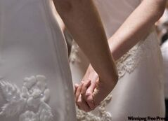 Amber Weiss and Sharon Papo, both of Berkeley, Calif., hold hands during their 2008 wedding ceremony at City Hall in San Francisco.