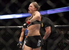 Ronda Rousey celebrates defeating Liz Carmouche after their UFC 157 women's bantamweight championship mixed martial arts match in Anaheim, Calif., Saturday, Feb. 23, 2013. The UFC is expanding its women's roster.The mixed martial arts organization is starting up a women's strawweight (115-pound) division, to add to the bantamweight (135-pound) weight class already on the books. THE CANADIAN PRESS/AP-Jae C. Hong