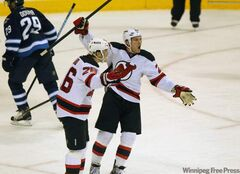 The New Jersey Devils' Patrik Elias (26) and David Clarkson (23) celebrate after Elias scored against the Winnipeg Jets during the 3rd period at the MTS Centre Saturday. The New Jersey Devils won, 2-1.