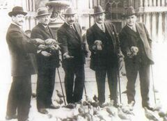 Hugo Ross (from left), unidentified companion, Thomas McCaffry, Mark Fortune and Thomson Beattie, feed pigeons in St. Mark's Square, Venice, in March 1912 -- a few weeks before the Titanic sailed.