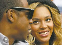 Beyoncel Knowles, right, looks at Jay-Z during the men's championship match at the U.S. Open tennis tournament in New York, Monday, Sept. 12, 2011. (AP Photo/Charles Krupa)