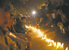 Indians participate in a vigil as they mourn the death of a gang-rape victim in New Delhi Saturday.